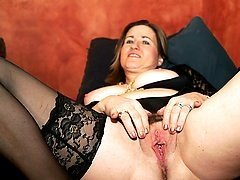 Kinky housewife playing with a huge dildo