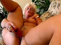 Blonde mature playing with red dildo in diff poses