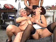Man in stockings jizzing on tits of two matures