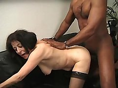 Aged mature in stockings tastes black dick on sofa