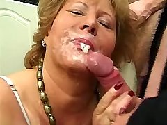 Chubby mature fucks with two guys and gets facials